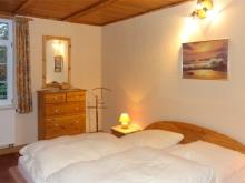 Schlafzimmer im Erdgeschoss mit Doppelbett - Ferienhaus Fam. Freitag Dresden